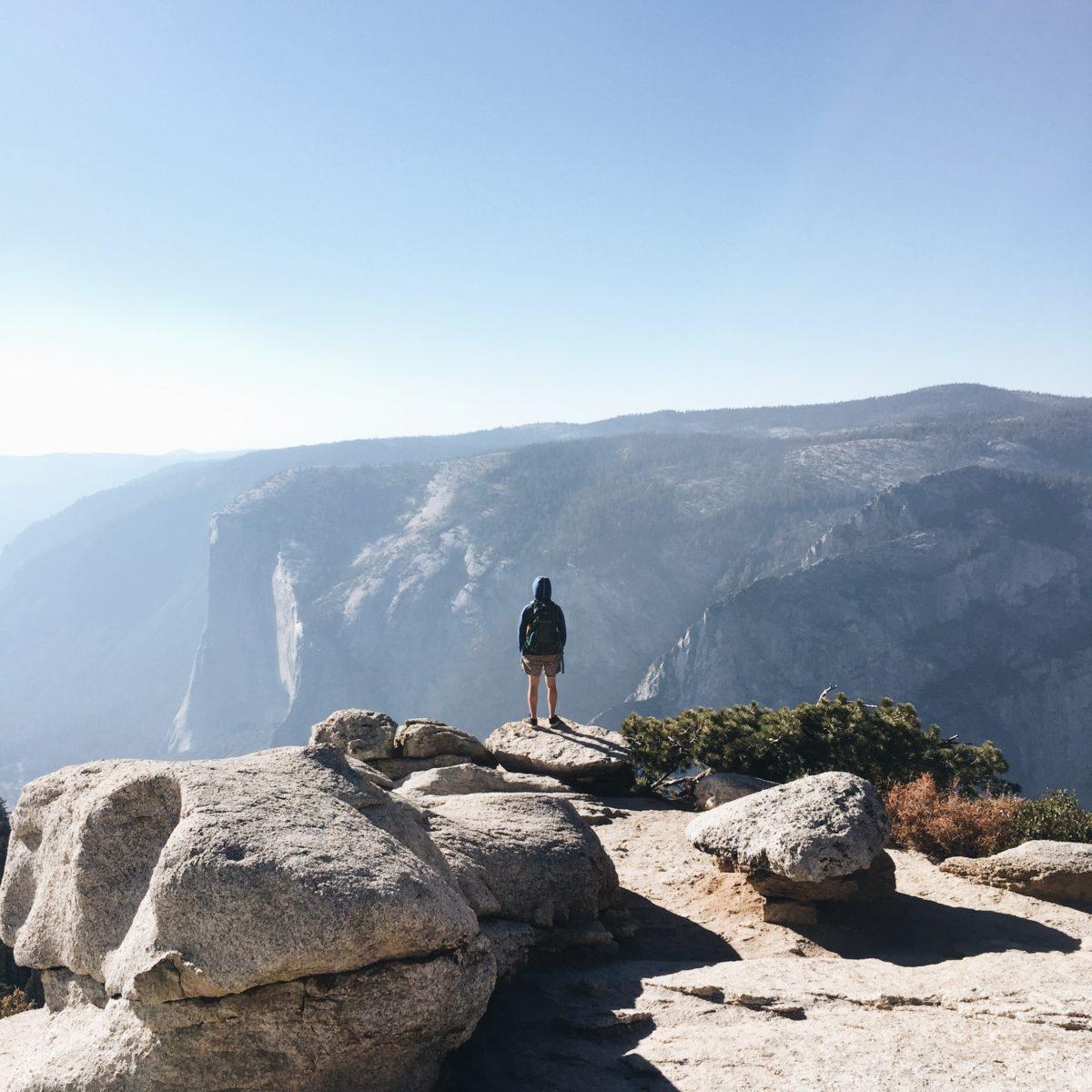 hiker facing el capitan in yosemite