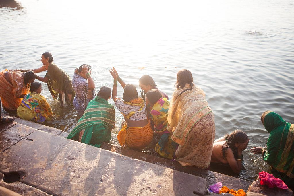 women in saris at riverfront