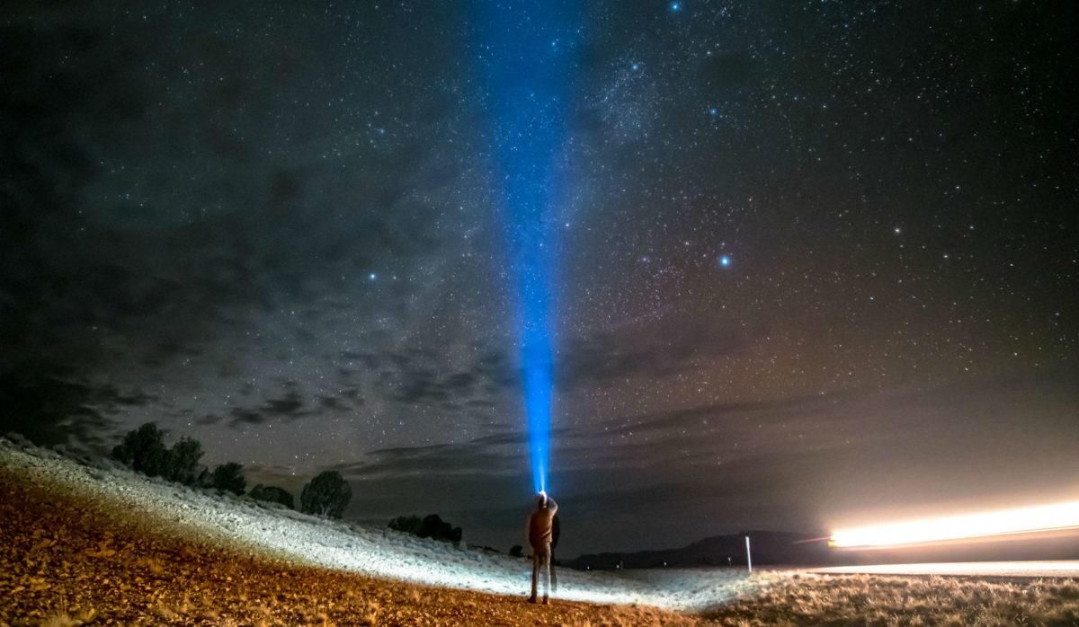 blue beam of light in utah night sky