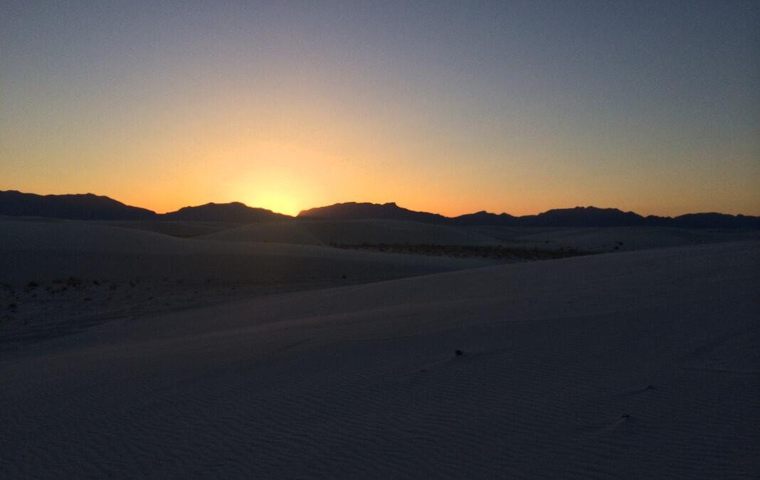 Sunset behind desert mountains