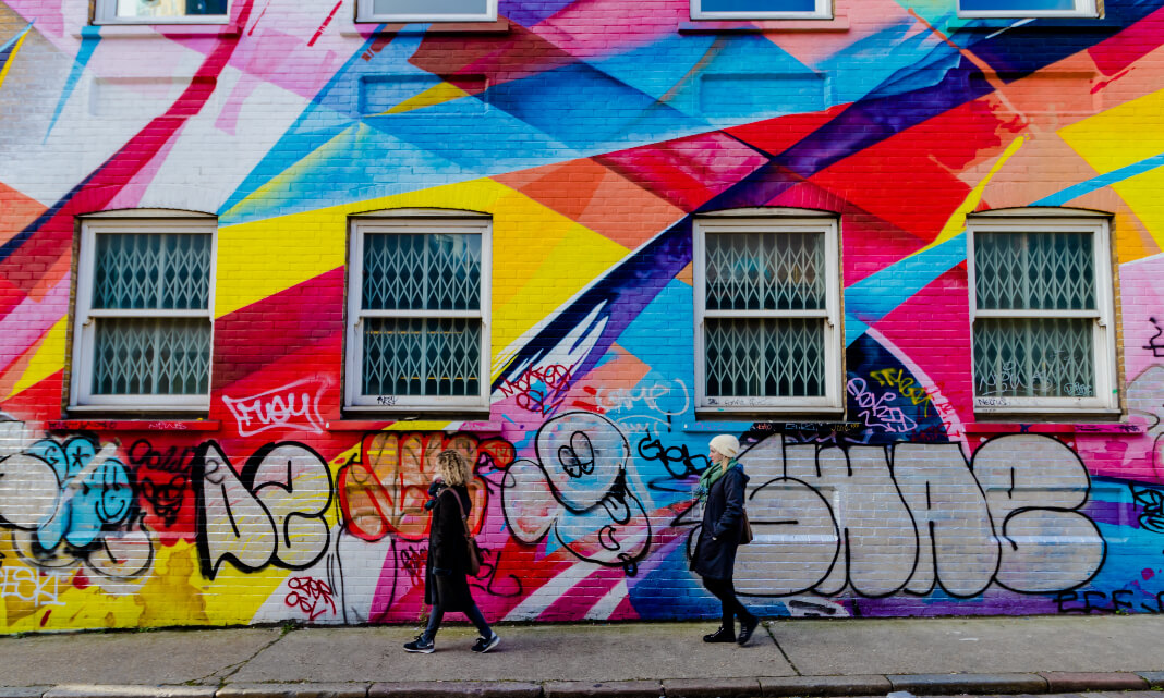 Rainbow street art on a building's side