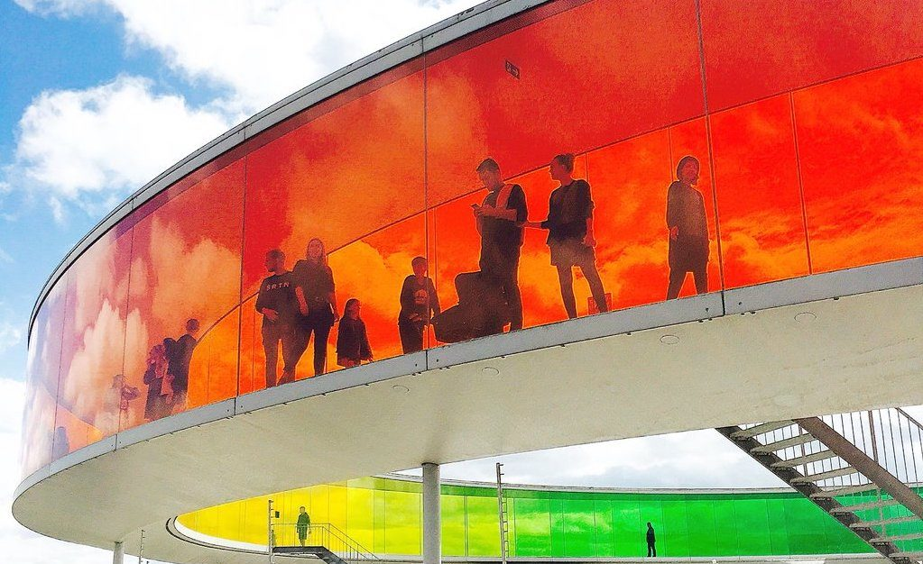 Red, yellow, and green mural on a circular structure