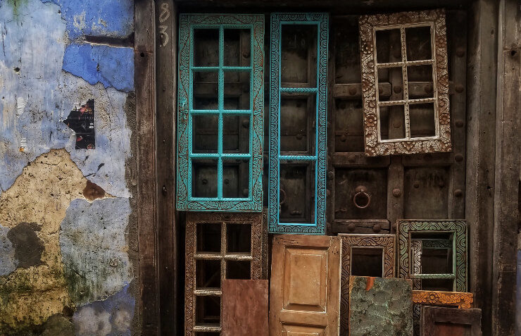 Old windows sit against a wall