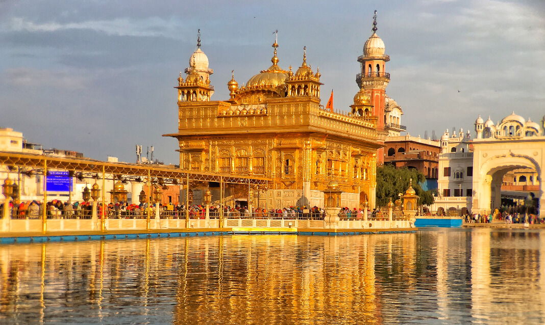 Golden buildings on the water's edge