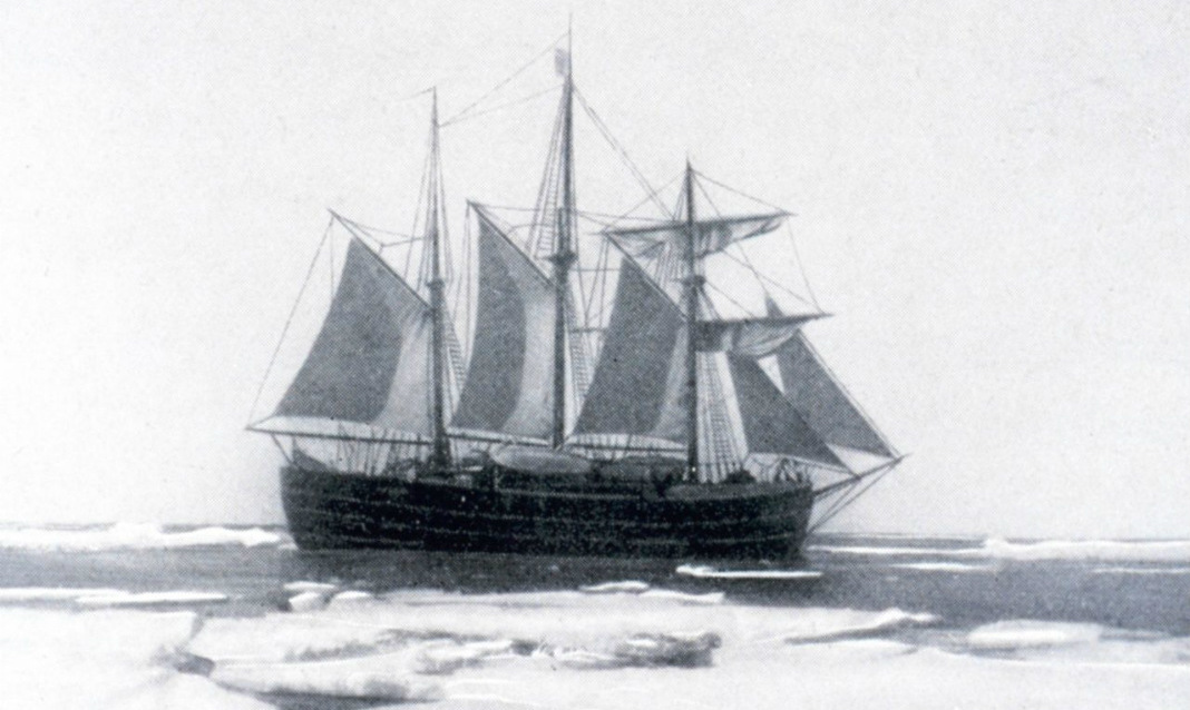 Black & white image of a ship on icy open waters