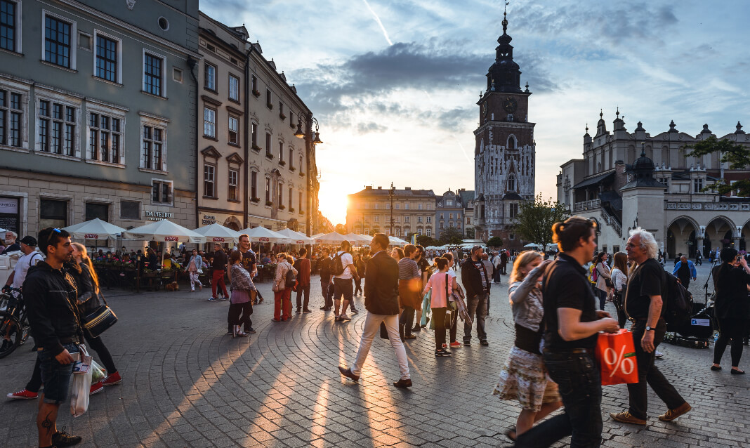 Pedestrians in a central square in Krakow, Poland