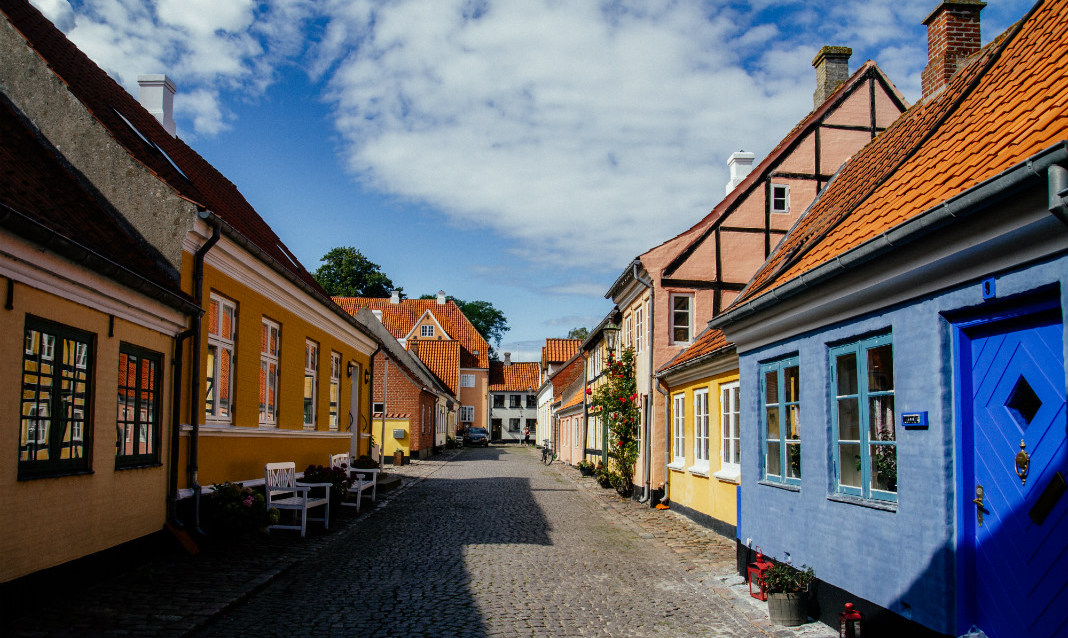 Brightly colored doors and homes in Ærø, Denmark, an island known for hosting weddings.