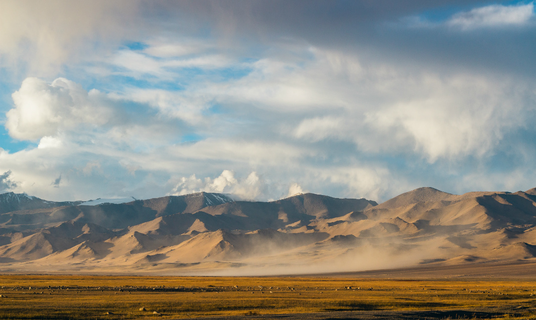 A series of mountains during Golden Hour on the Pamir Highway.