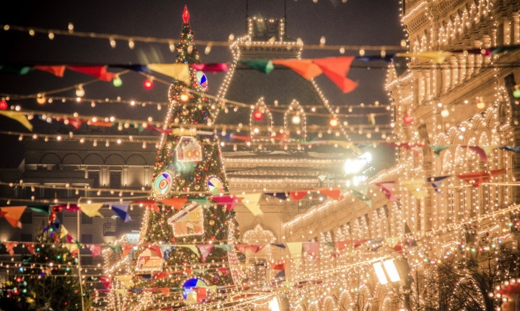 A brightly lit holiday market in Moscow, Russia.
