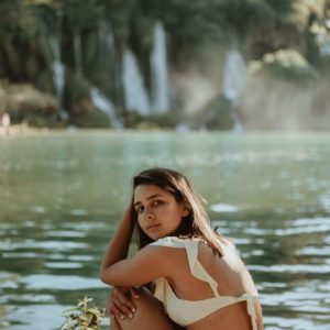 girl in swimsuit by lake