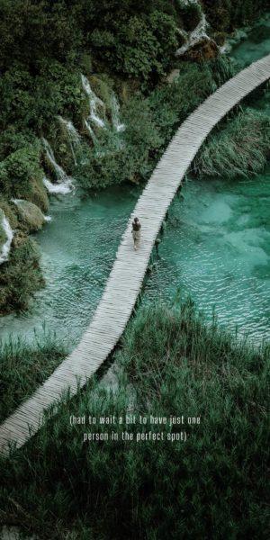 winding walkway over turquoise water