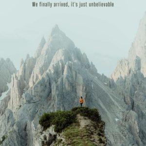 man scaling mountain