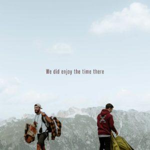 men carry camping gear