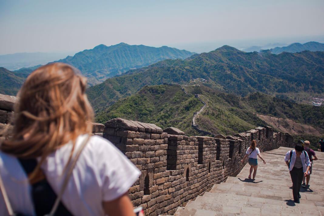 woman walking on great wall of china