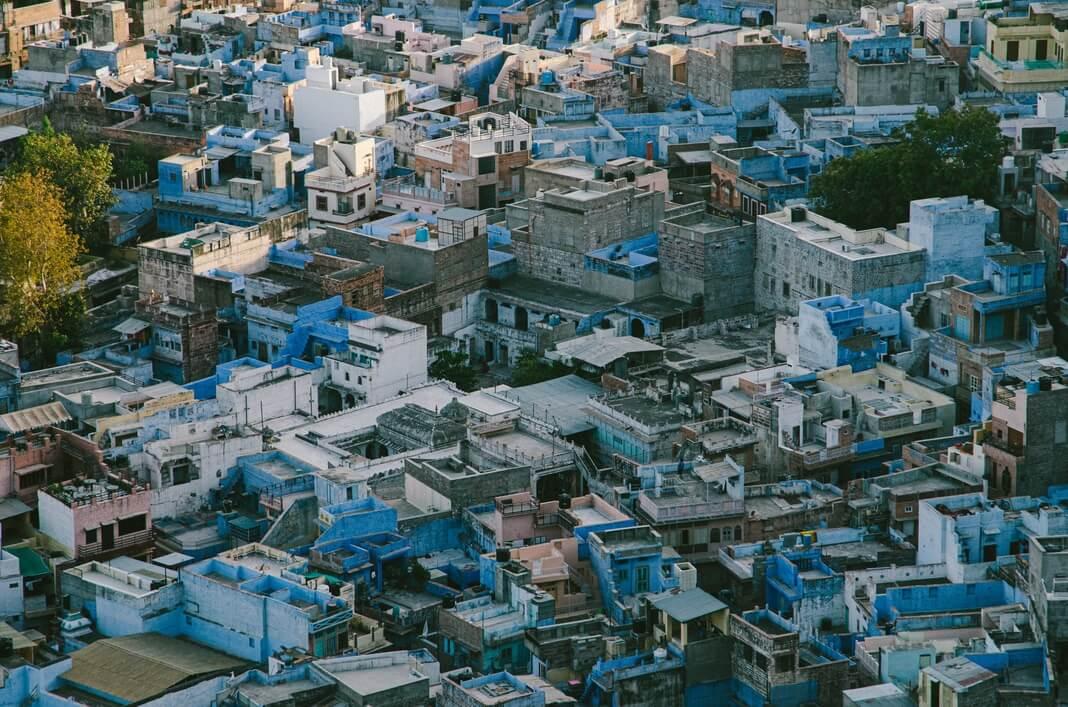 clustered blue homes on a hillside