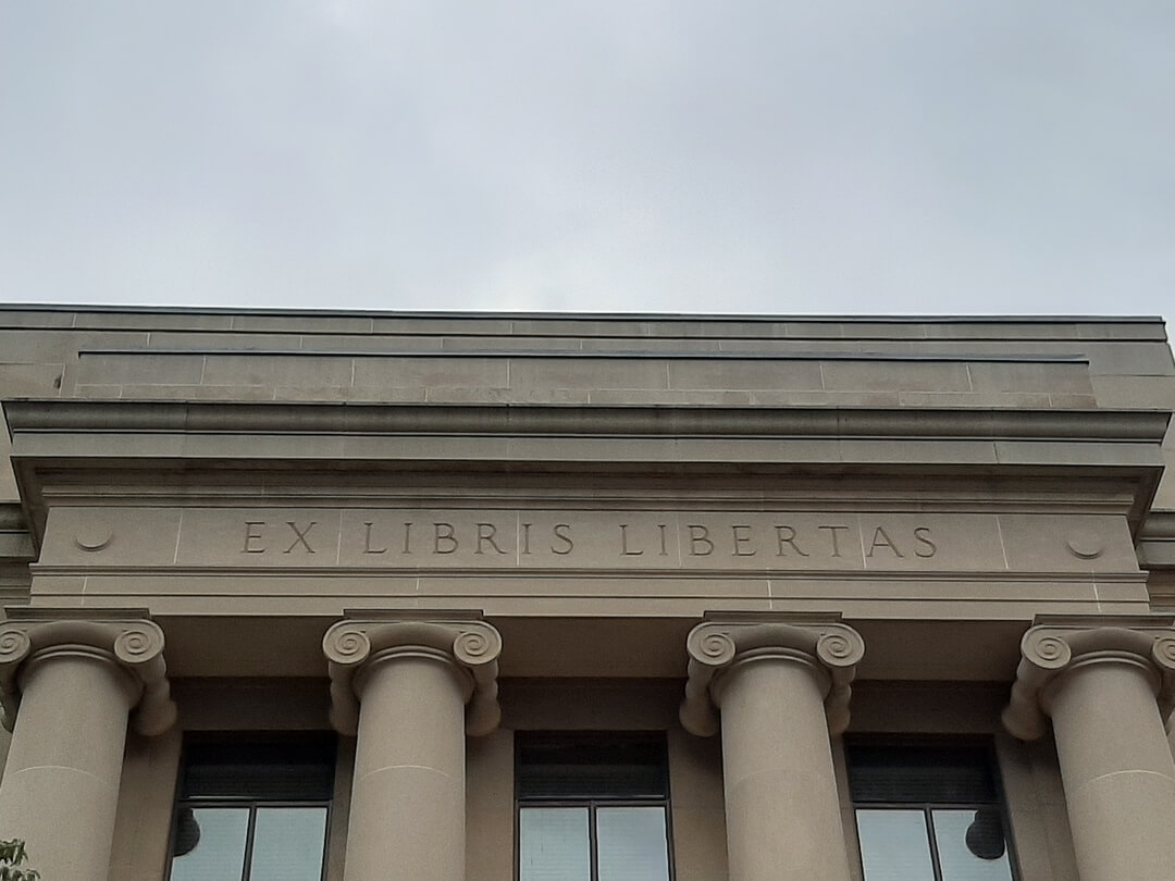 columns reading inspirational quote from books, freedom in latin